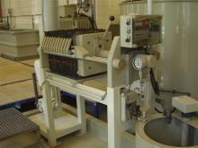 Sewage treatment mud filter-press
